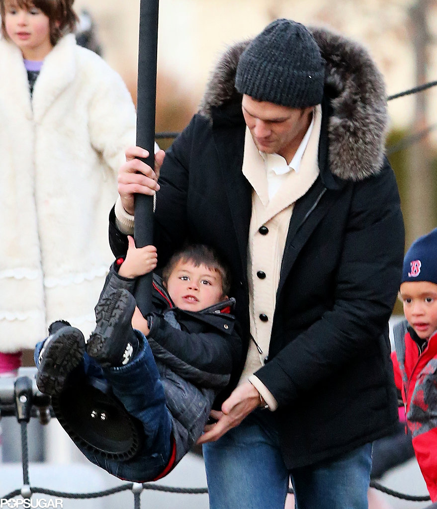Tom Brady helped Benjamin swing on a thick rope.