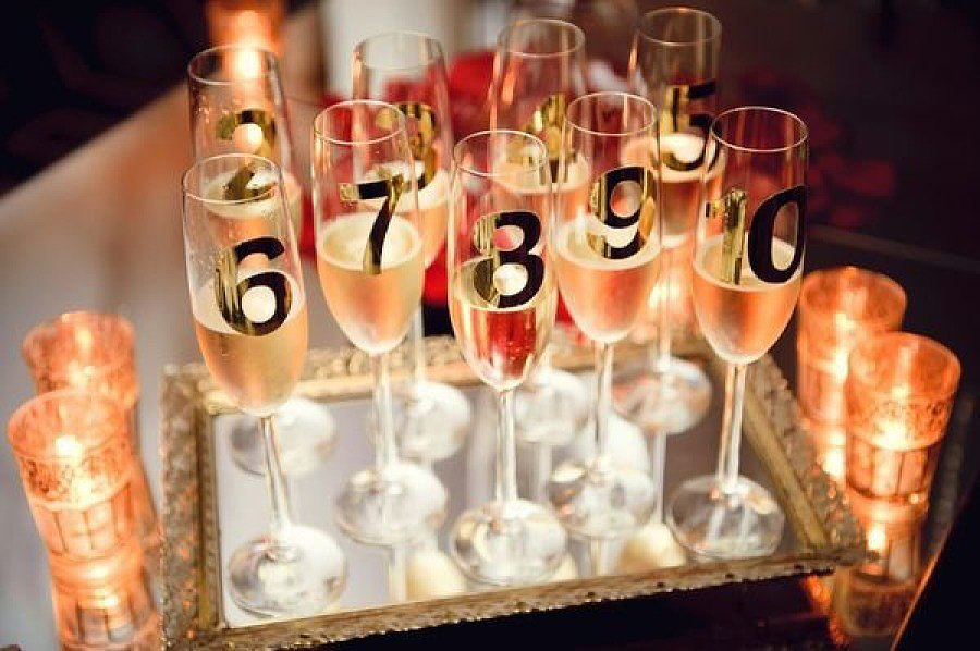 Have numbered champagne glasses for the countdown to the new year. Photo by Avery House via Style Me Pretty