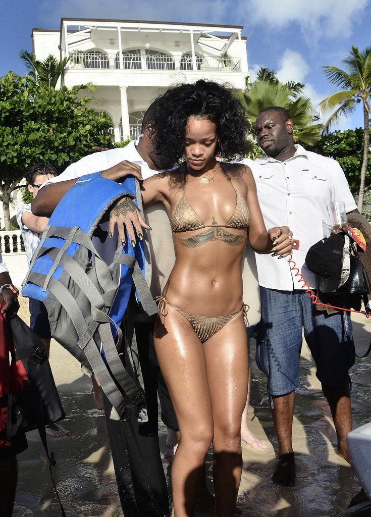 Rihanna showed off her bikini body before a little Jet Ski fun during her Barbados getaway.