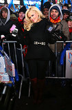 Jenny McCarthy donned a black coat and dark red boots to ring in the New Year in Times Square.
