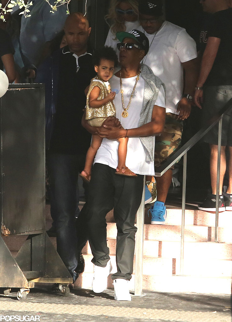 Blue Ivy showed some sass as her dad, Jay Z, carried her.