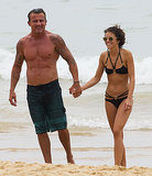 AnnaLynne and Dominic held hands on the beach.