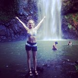 "2 Broke Girls star Beth Behrs posed in front of a waterfall during her tropical vacation, saying, ""Can't believe it's our last day in this paradise."" Source: Instagram user bethbehrsreal"