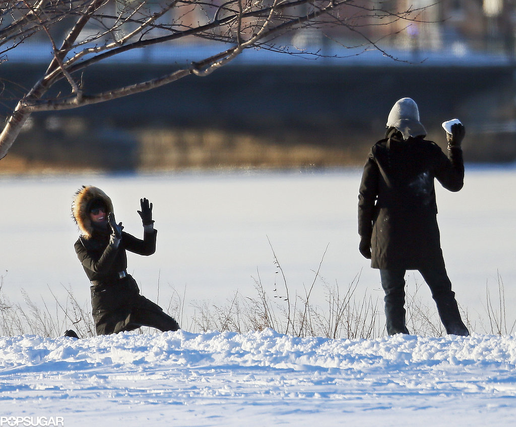 Gisele and Tom had a snowball fight during their stroll in Boston.