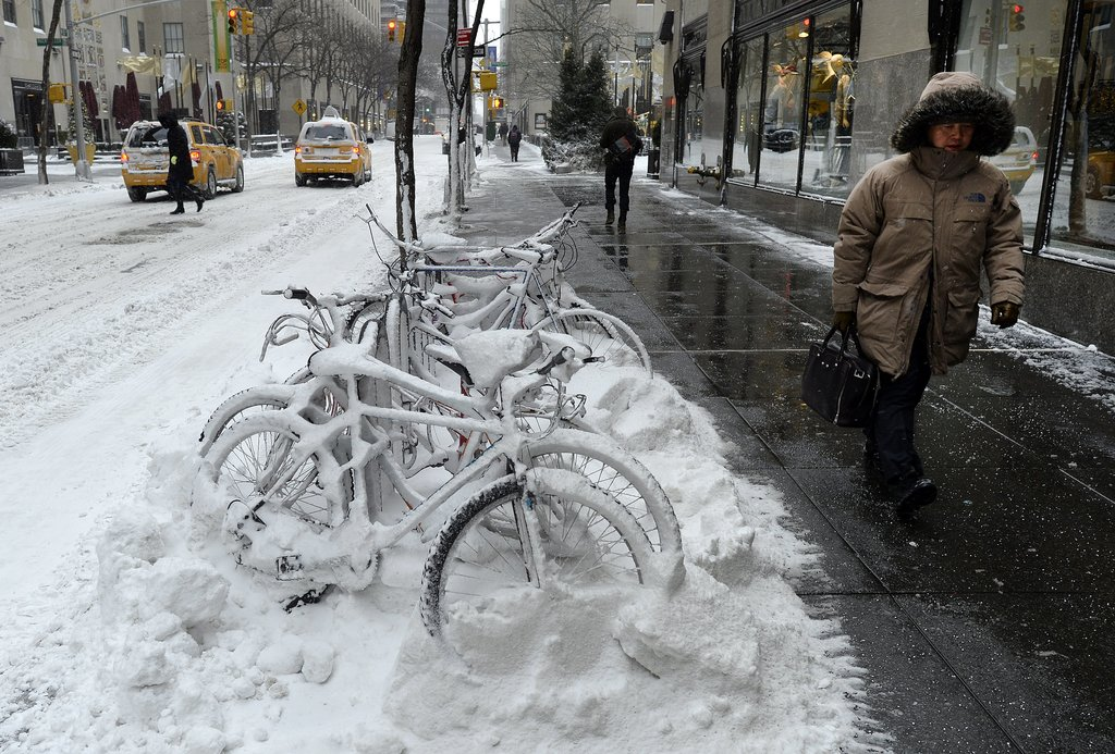 A pile of bicycles was buried beneath inches of snow in NYC after the Winter storm hit the city.