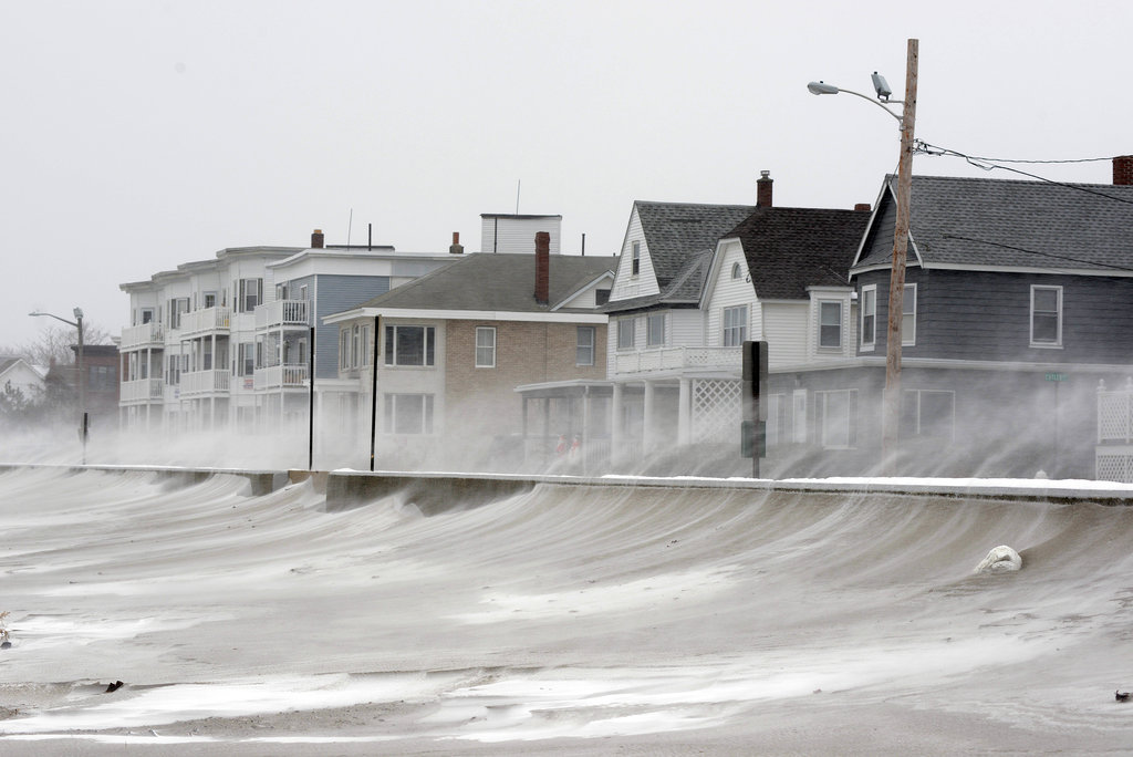 Areas north of Boston saw nearly two feet of snow during the first night of the storm, and strong winds blew snow across the beach in Winthrop, MA.