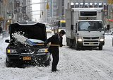 A man dug his limo out of the snow on NYC's 6th Avenue.