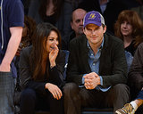 Mila and Ashton sat courtside.