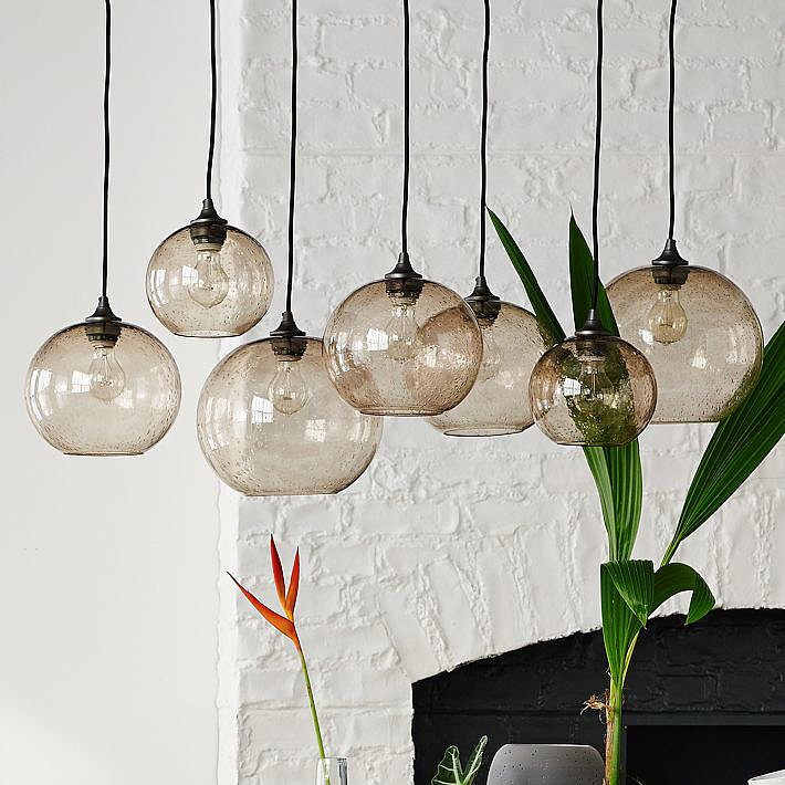 Get the look of expertly staggered pendants with this all-in-one Glass Orb Chandelier ($499).