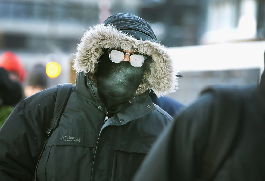 A man's glasses looked nearly frozen as he made the morning commute.