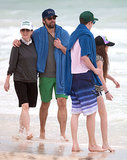 Julianne walked with her family on the beach.