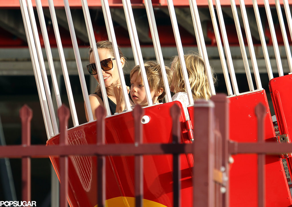 Angie smiled while in a ride with her little ones.