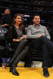 Jessica Alba kicked up her heels in Coach boots while sitting courtside at a Lakers game.