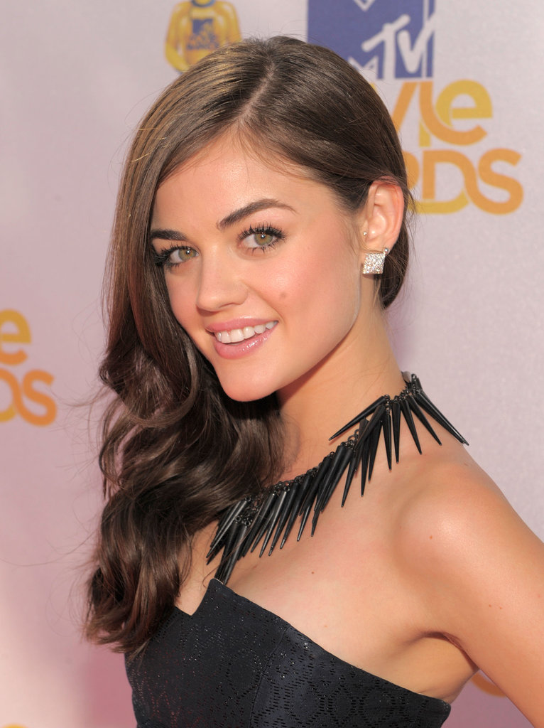 In 2010, Lucy Hale arrived as the fresh-faced star of Pretty Little Liars. At the MTV Movie Awards that year, she glowed thanks to a golden makeup palette, which was complemented by — you guessed it — sideswept Old Hollywood waves.