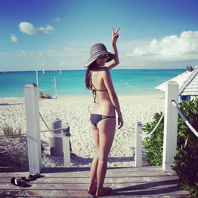 Jamie Chung flashed a peace sign while showing off her bikini body in Turks and Caicos in January 2014. Source: Instagram user jamiejchung