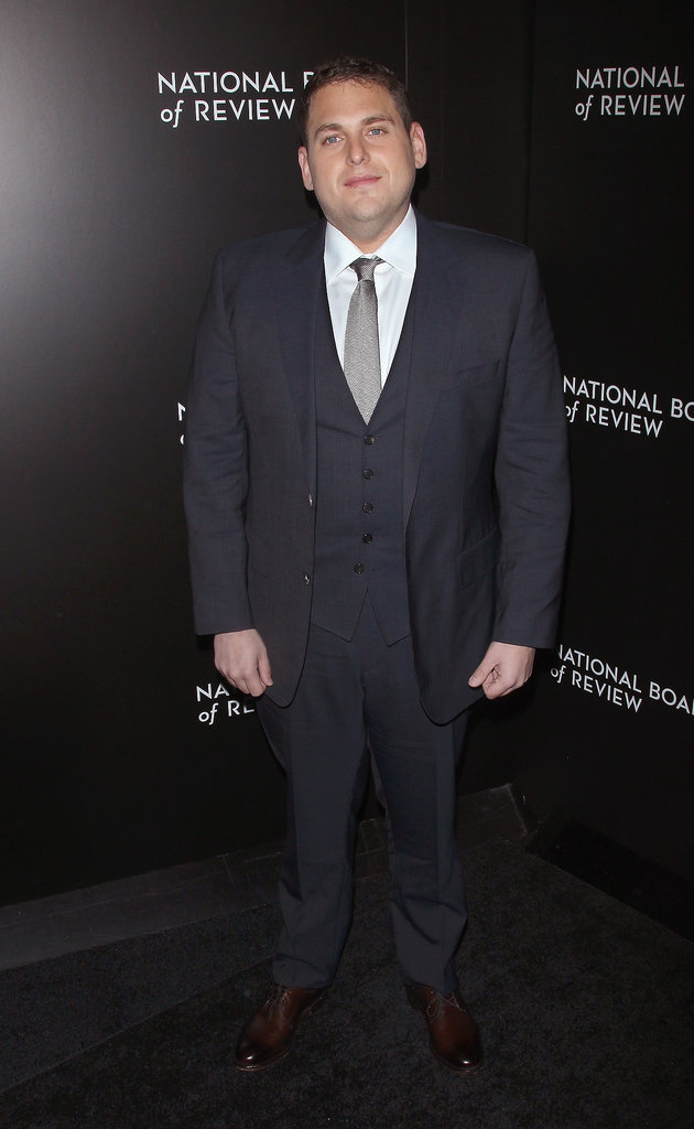 Jonah Hill wore a dark gray suit.