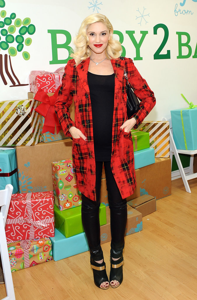 Gwen used her red plaid coat to get into the spirit during a holiday party out in LA.