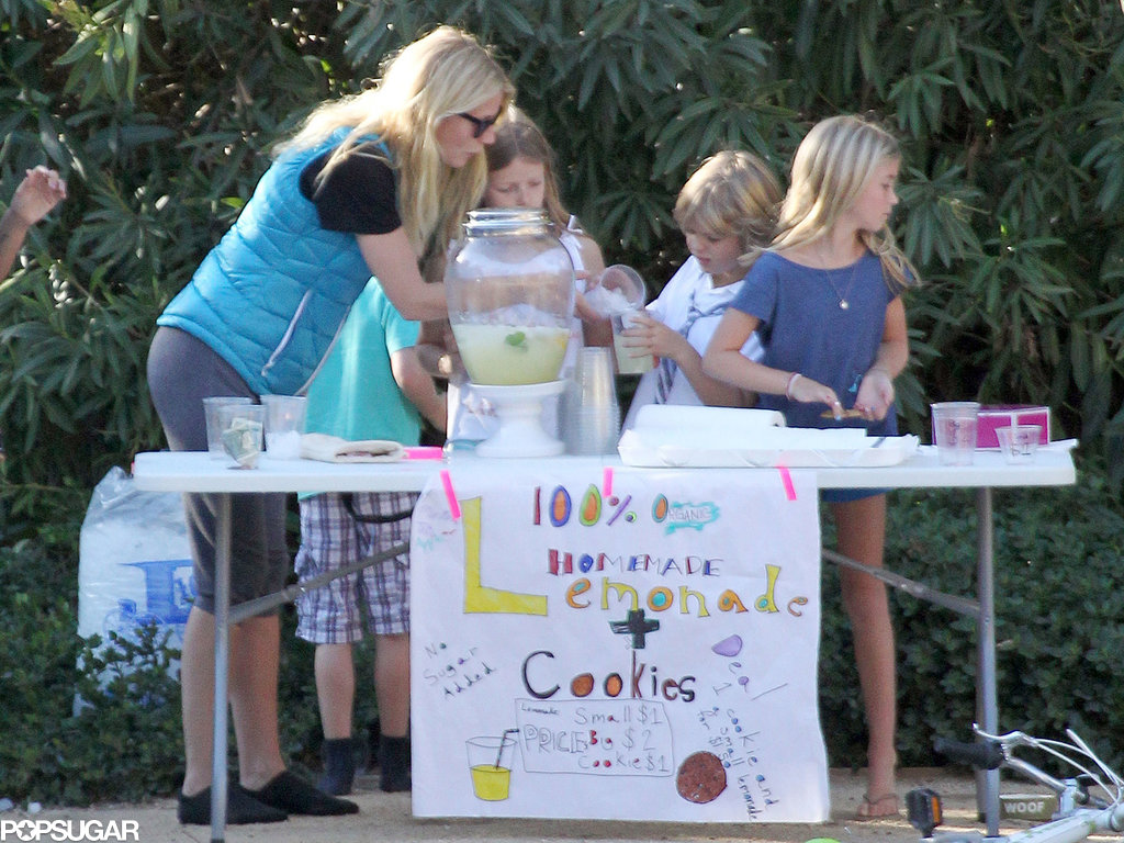 Gwyneth Paltrow helped her kids, Apple and Moses Martin, sell cookies and lemonade on a street corner in LA's Pacific Palisades neighborhood.
