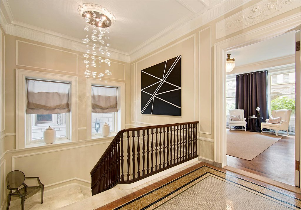 Any stairwell feels sophisticated with a chandelier and some artwork. Source: Douglas Elliman Real Estate