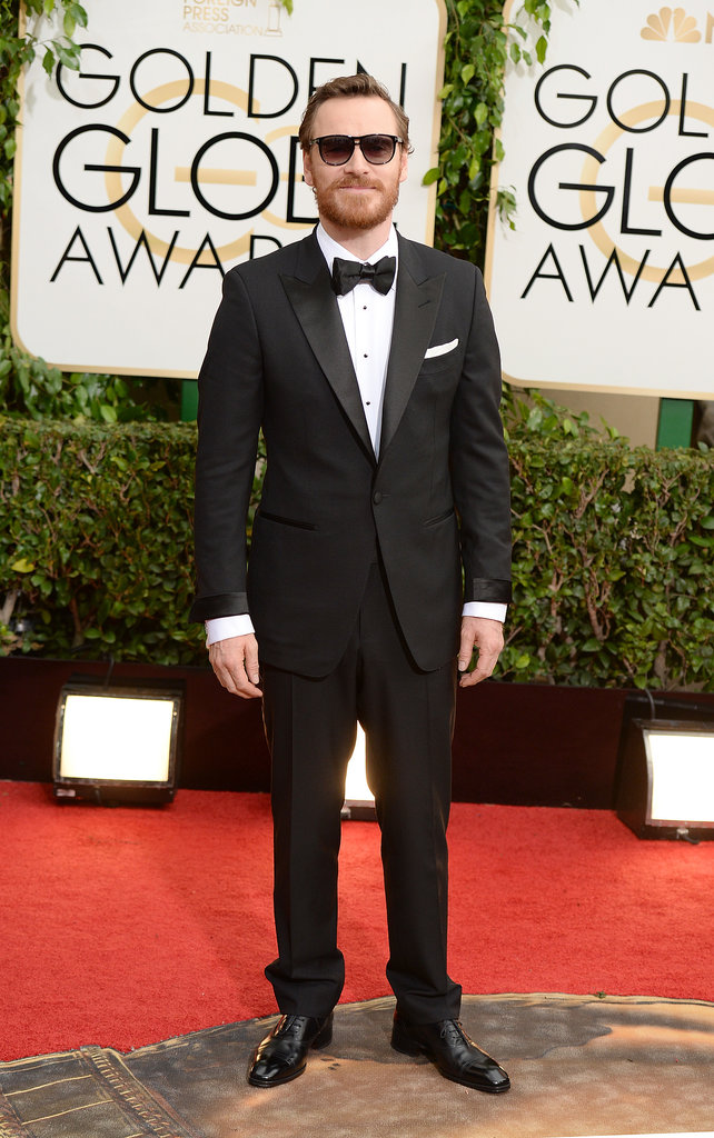 Michael Fassbender shaded his eyes from the sun as he hit the red carpet.