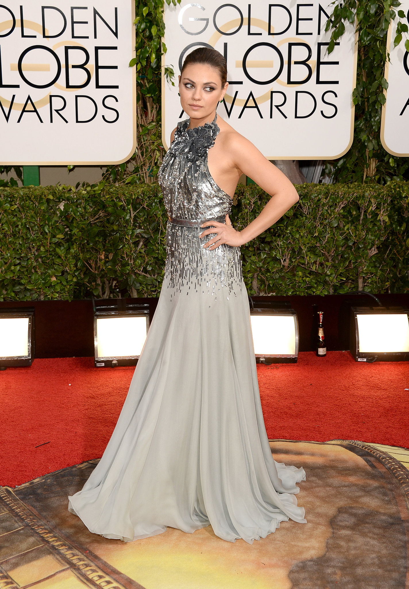 Mila Kunis showed up for her presenting gig at the Golden Globes.