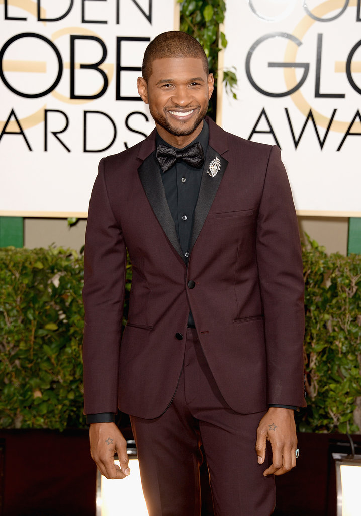 Usher looked dapper on his way into the show.