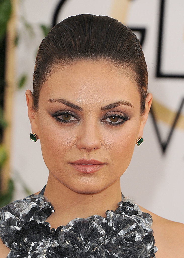 Mila Kunis channeled her inner black swan with smoky eye shadow and a slick ballerina bun.