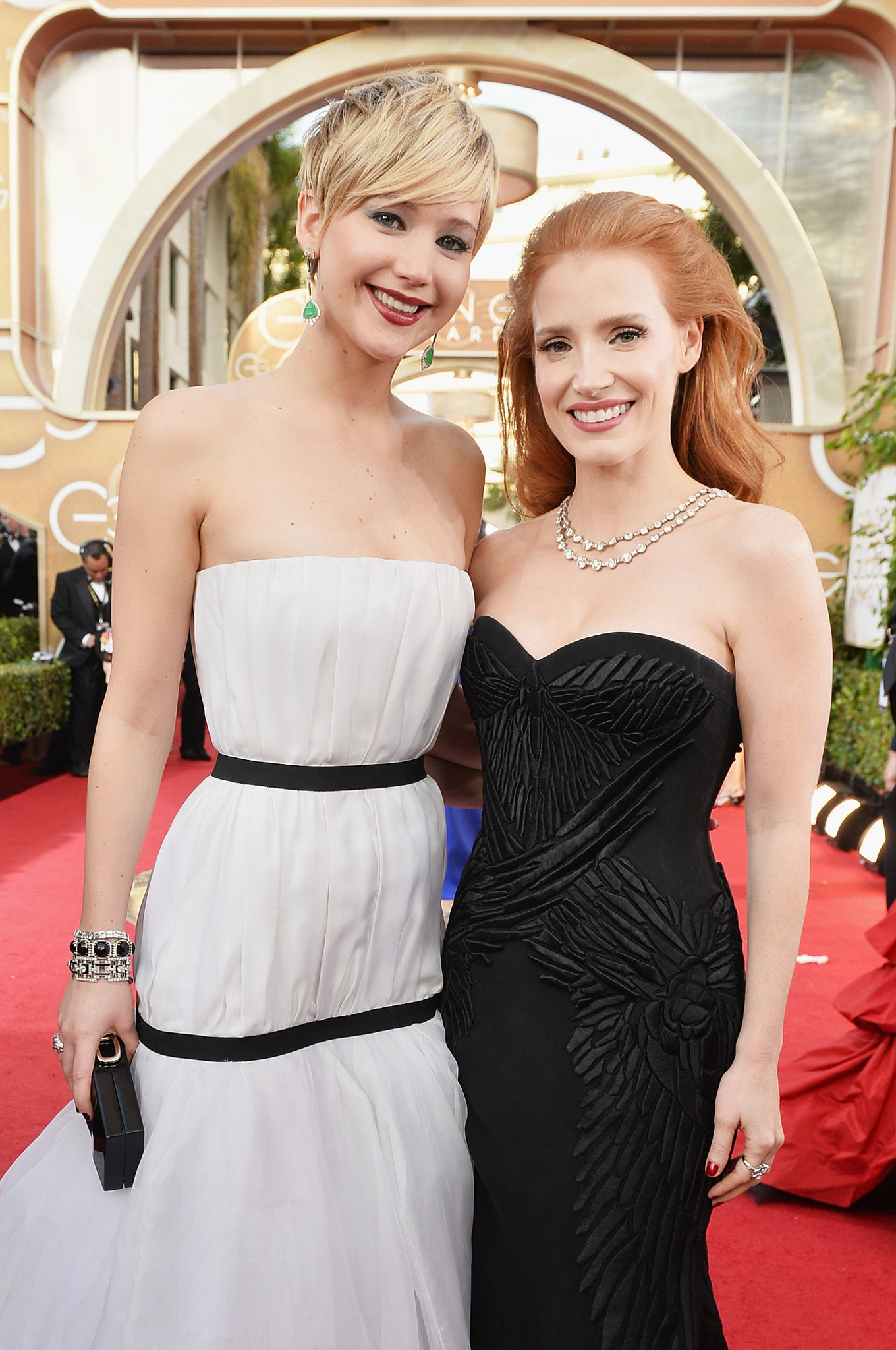 Jennifer Lawrence and Jessica Chastain were all smiles on the Golden Globes red carpet.