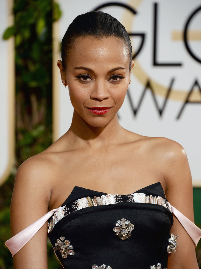 Zoe Saldana's slicked-back strands and inky eyeliner oozed high fashion.