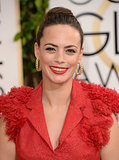 Bérénice Bejo enhanced the vibrancy of her ruffled gown with an equally bold lip color.
