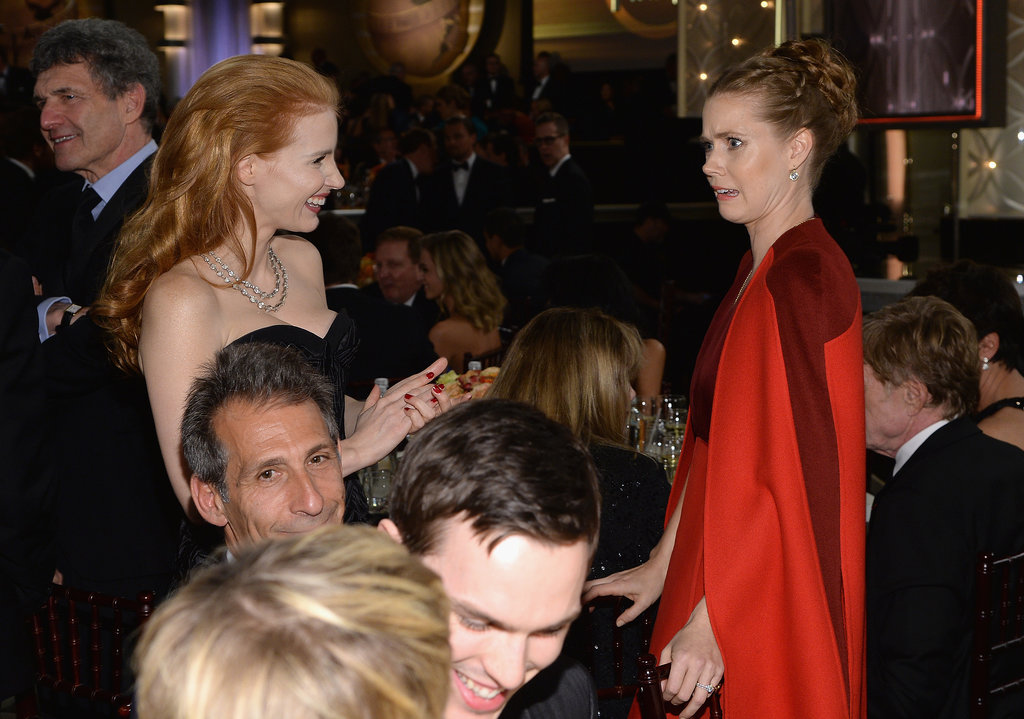 Jessica Chastain and Amy Adams chatted next to Jennifer Lawrence and Nicholas Hoult's table.  Source: Larry Busacca/NBC/NBCU Photo Bank/NBC