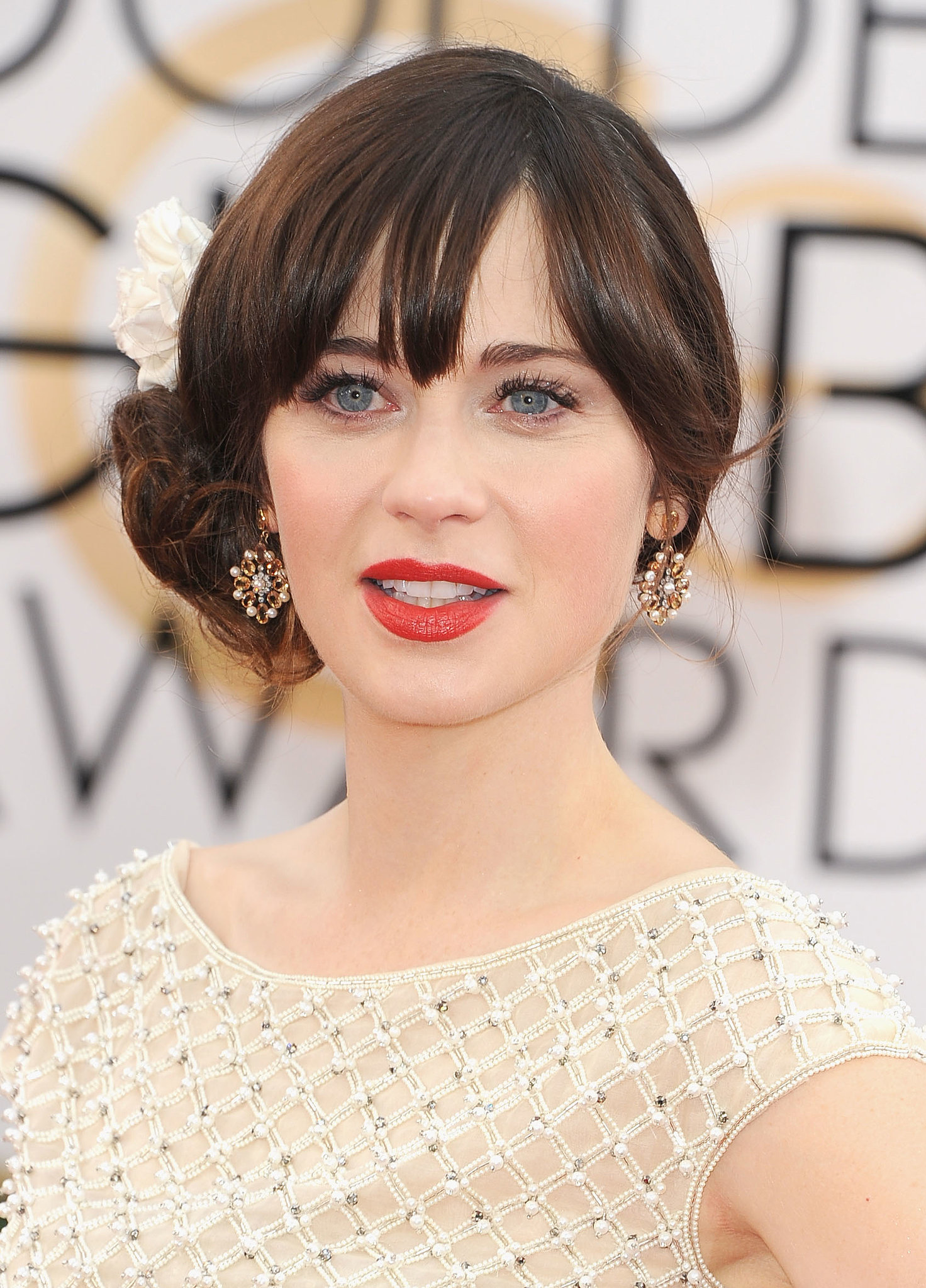 Zooey Deschanel added to her dress's charm with a pair of Neil Lane pearl, citrine and pla