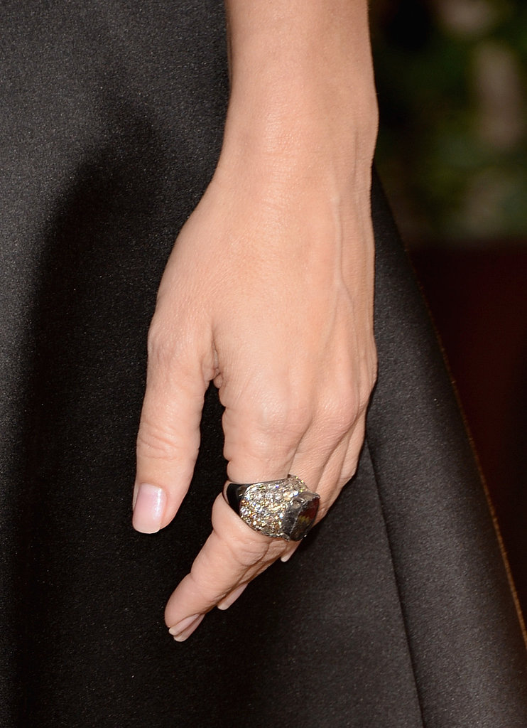 Sandra Bullock slipped a pretty megawatt diamond ring on her finger — a Lorraine Schwartz cocktail ring set with a 15-carat black diamond and surrounded by 10 carats of brown diamonds.