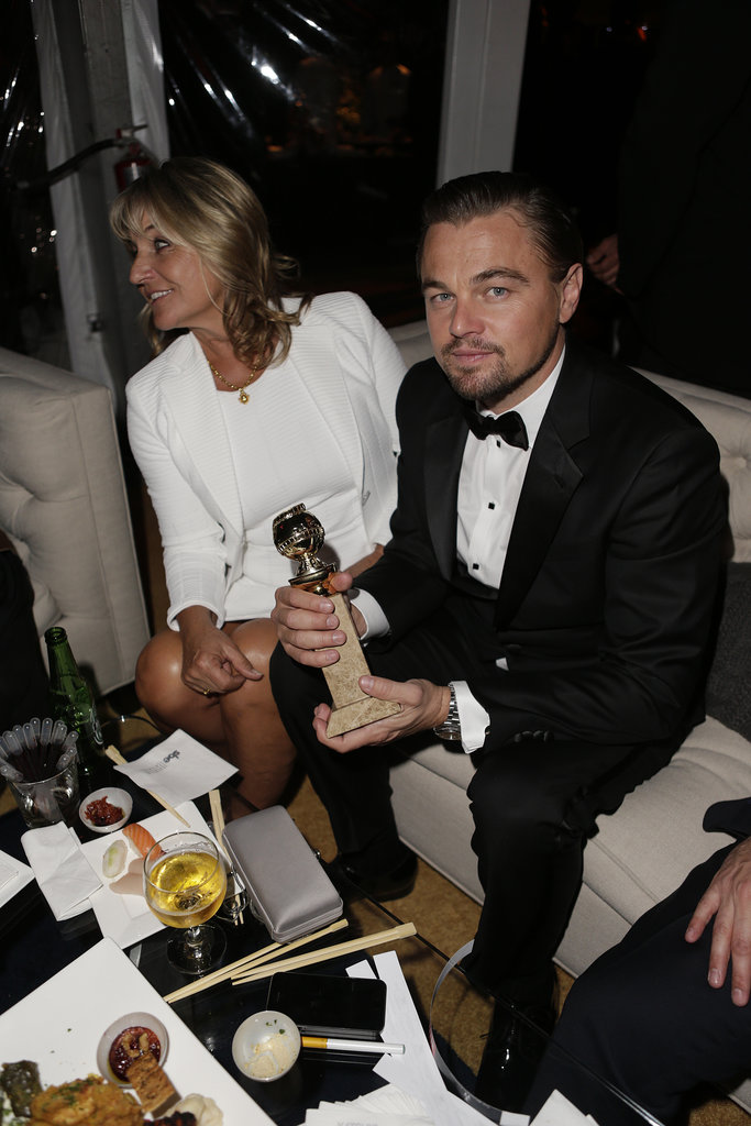 Leonardo DiCaprio held onto his best actor statue and sat next to his mom.