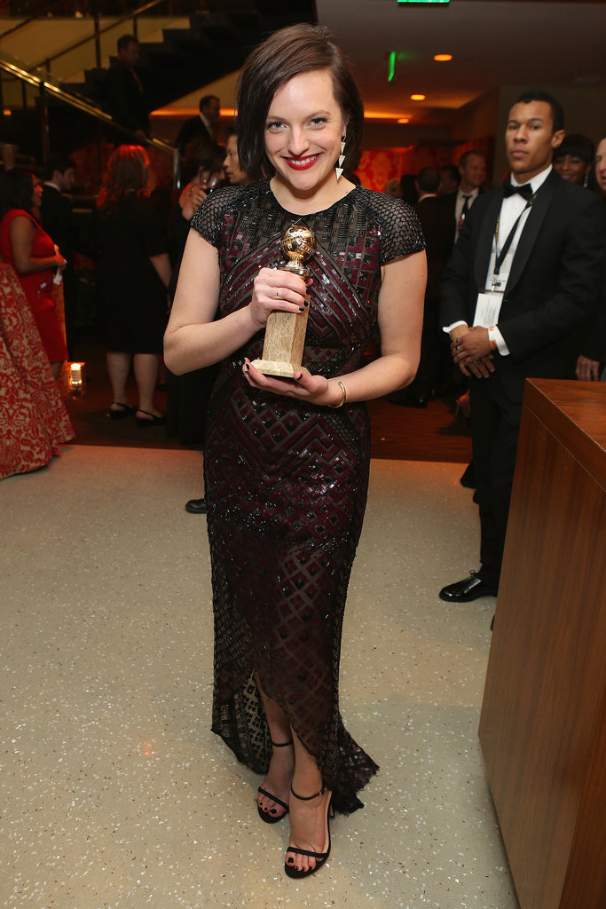 Elisabeth Moss showed off her Golden Globe.