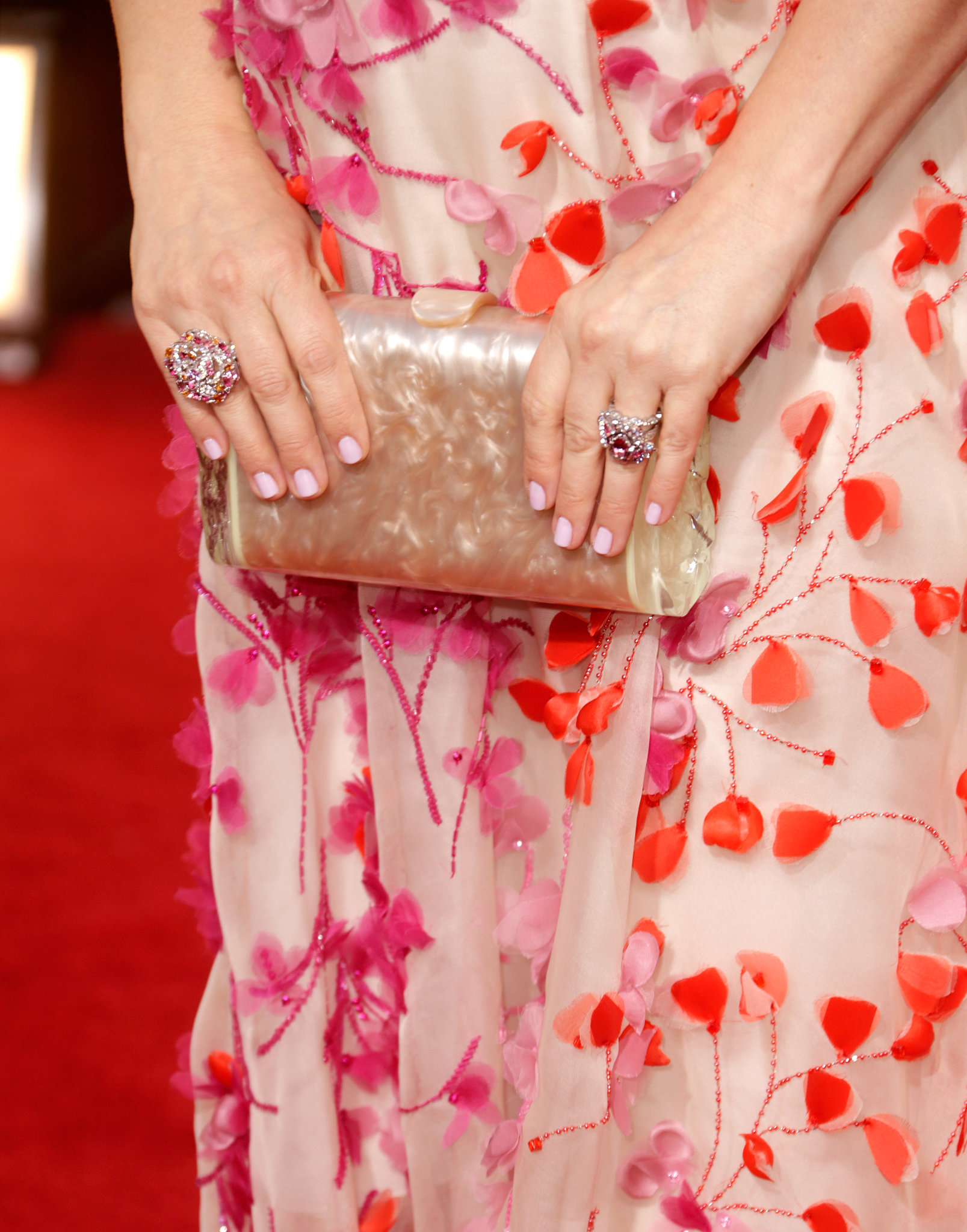 Drew added pretty Chanel Fine Jewelry rings and an Edie Parker clutch to her look.