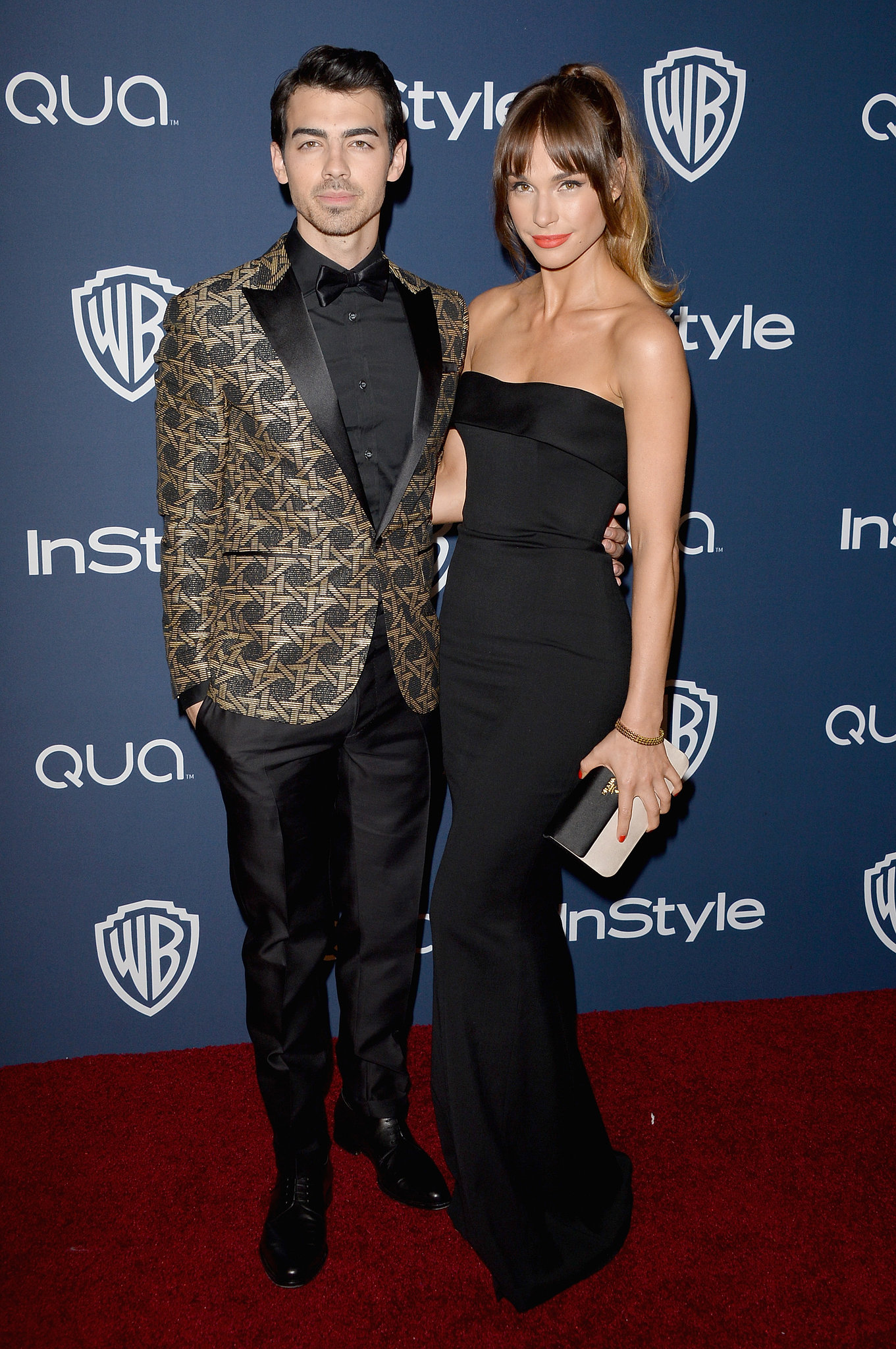 Joe Jonas and his girlfriend, Blanda Eggenschwiler, posed together as they arrived for the party.
