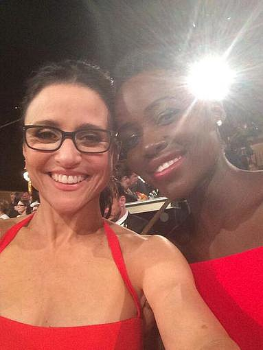 Comedy mainstay Julia Louis-Dreyfus smiled wide with newcomer Lupita Nyong'o at the 2014 Golden Globes. Source: Twitter user OfficialJLD