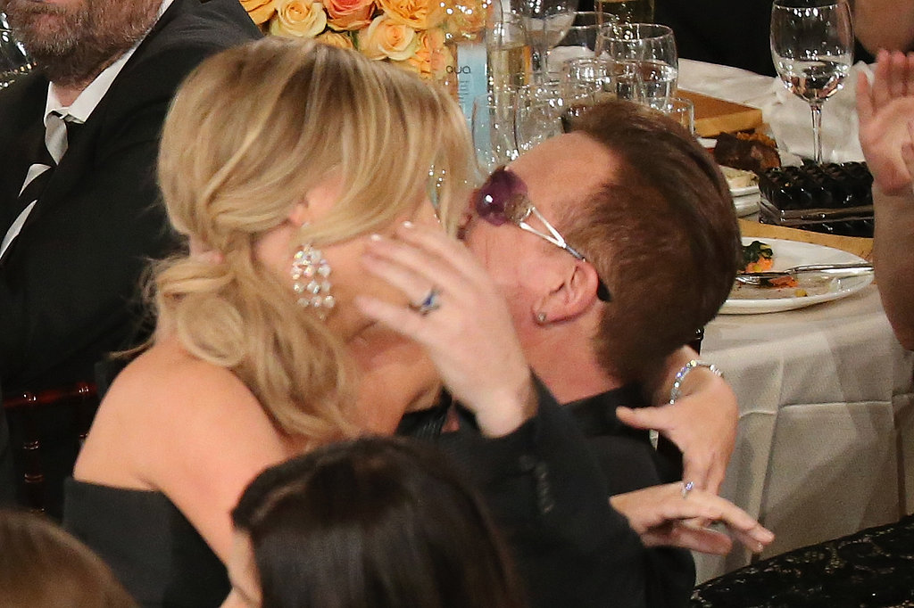 Amy Poehler sealed her Globes win with a makeout session with Bono.  Source: Christopher Polk/NBC/NBCU Photo Bank/NBC