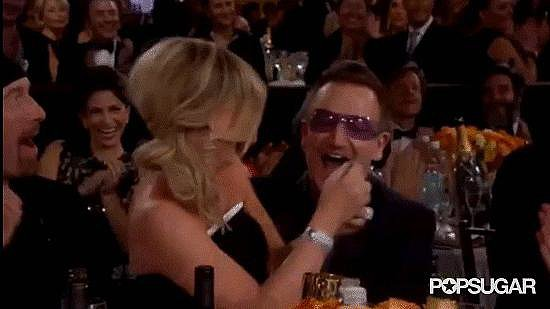 5. Amy Poehler Makes Out With Bono Before Accepting Her Award