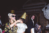 Beyoncé held on to Blue Ivy as they wore festive party hats. Source: Tumblr user Beyoncé Knowles