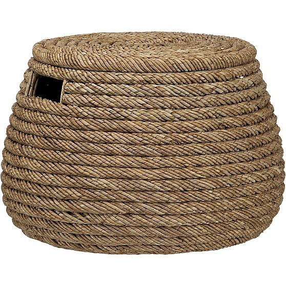 Thanks to the size of this Roll Weave Storage Basket ($80), it works just as well as a side table.