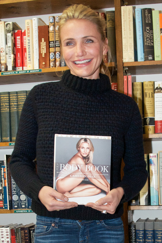cameron diaz poses with her book