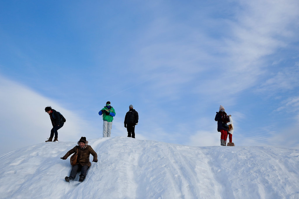 Tourists took turns sledding during the Harbin International Snow Sculpture Art Expo in China.