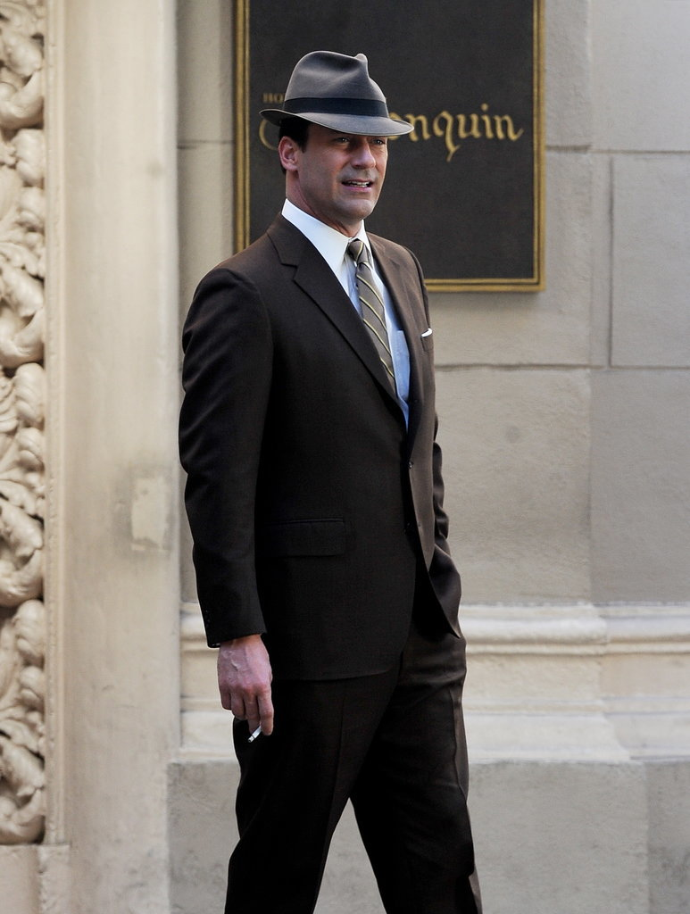 Jon Hamm channeled his inner Don Draper and lit up a cigarette while filming scenes for Mad Men in LA on Tuesday.