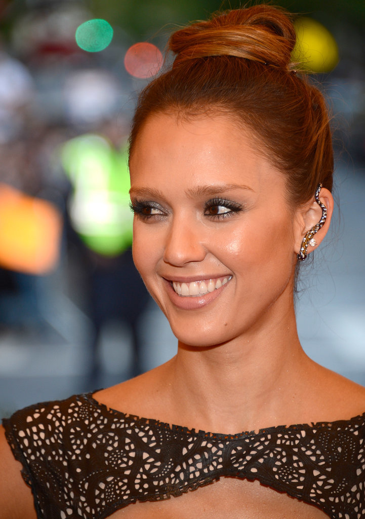 Jessica Alba offset a high bun with an edgy, embellished piece covering the whole of her ear at the Met Gala.