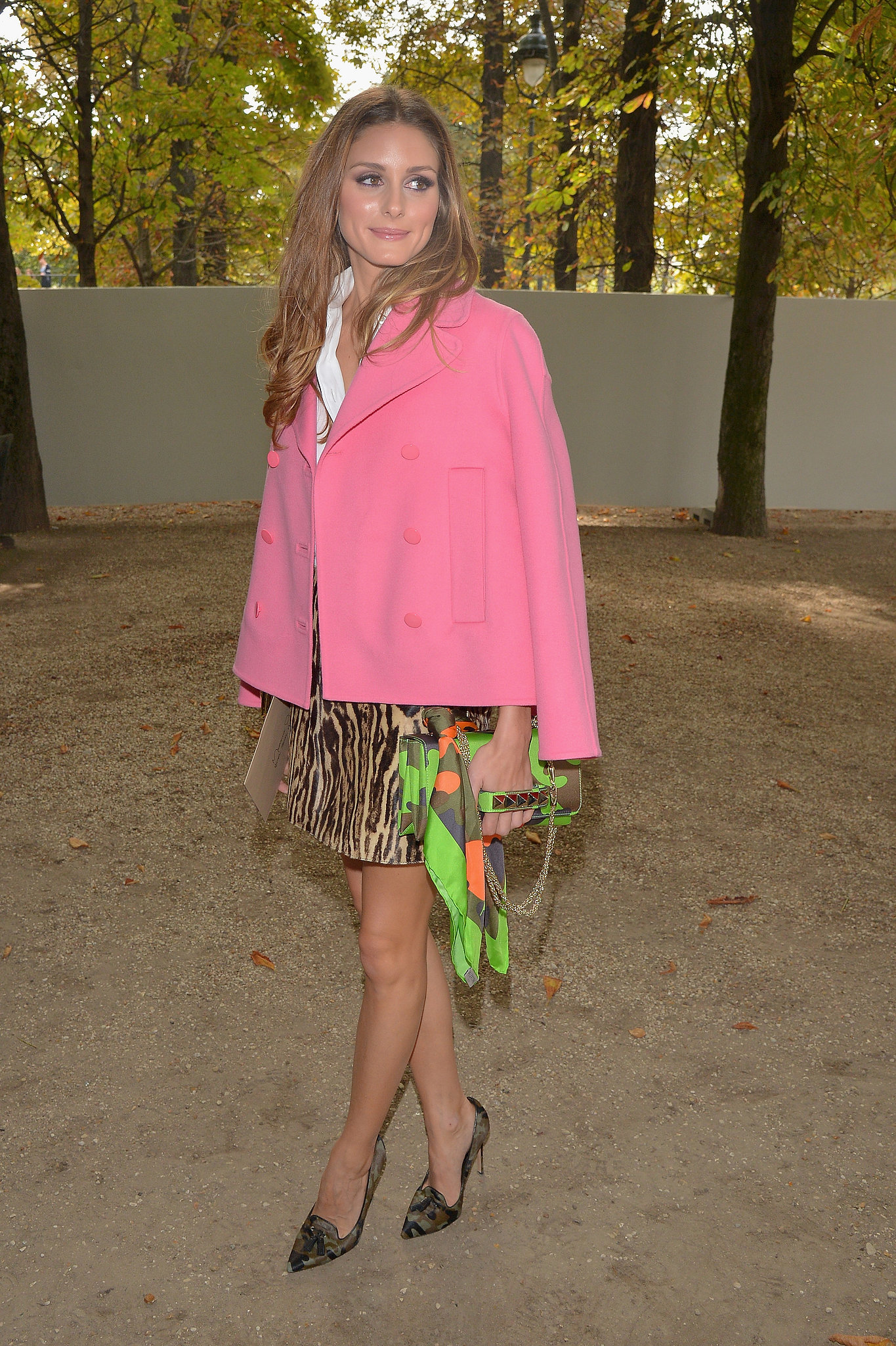 Olivia Palermo tempered a leopard-print miniskirt with a bright pink peacoat while taking in the shows during Paris Fashion Week Spring/Summer