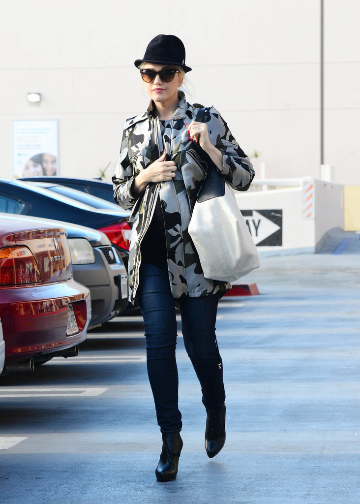 With a camo coat thrown over her jeans and a t-shirt, Gwen made her running-errands look way more stylish than most.