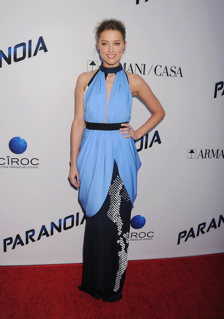 She made a dramatic turn in a draped and colorblock column at the LA Paranoia premiere.