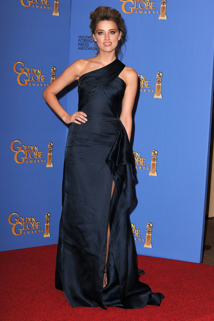 Amber smoldered in a high-slit, navy gown on the Golden Globes red carpet.